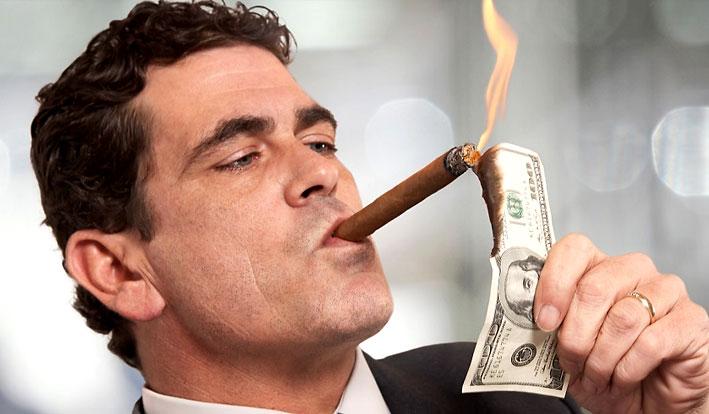 man-burning-money