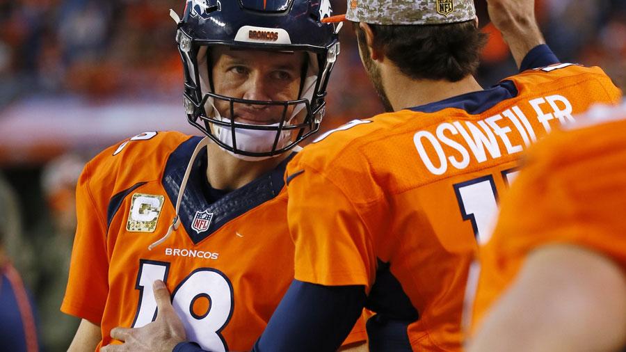Peyton Manning and Brock Osweiler, quarterbacks of the Denver Broncos.
